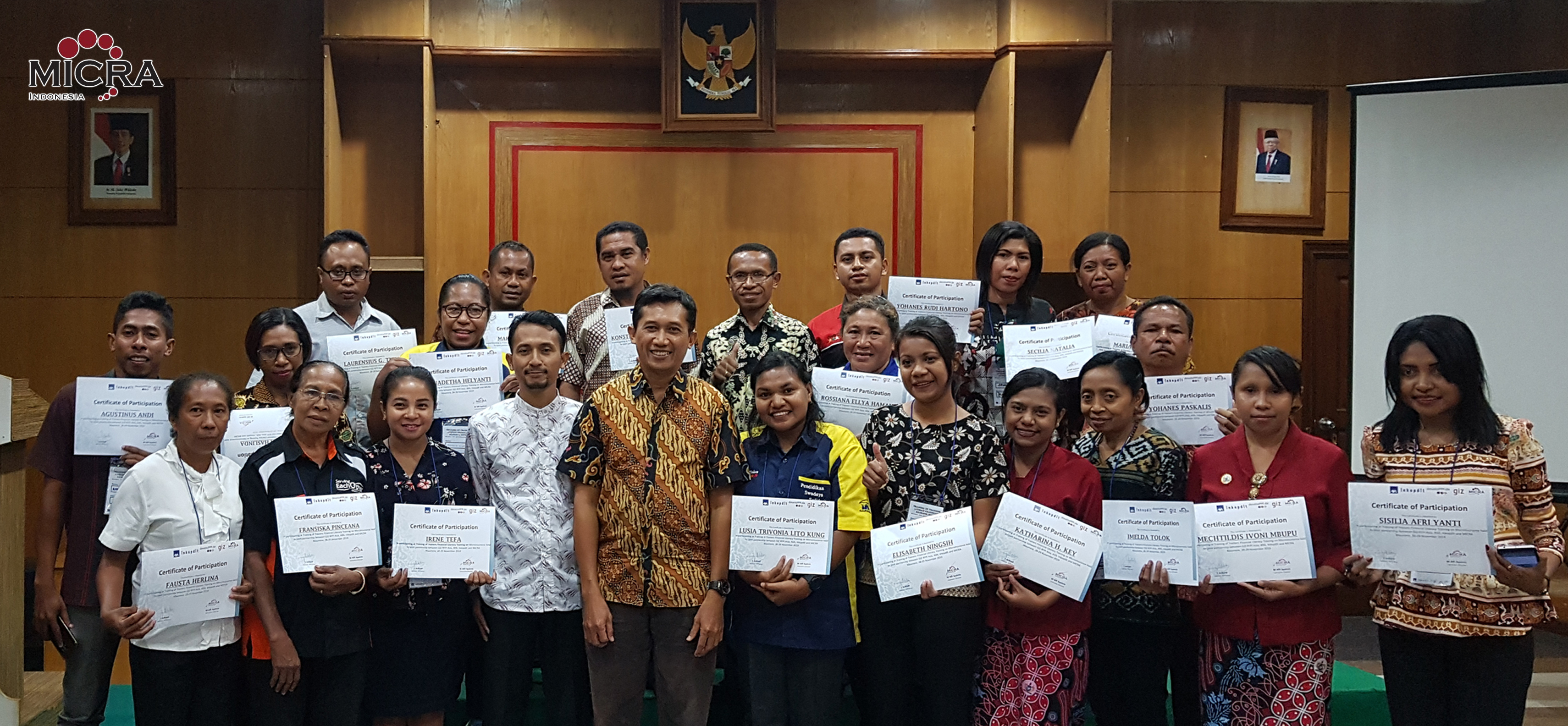 Picture of MICRA Trainer M. Faishol Khusni and GIZ Indonesia Y. Arihadi with some of ToT Maumere participants